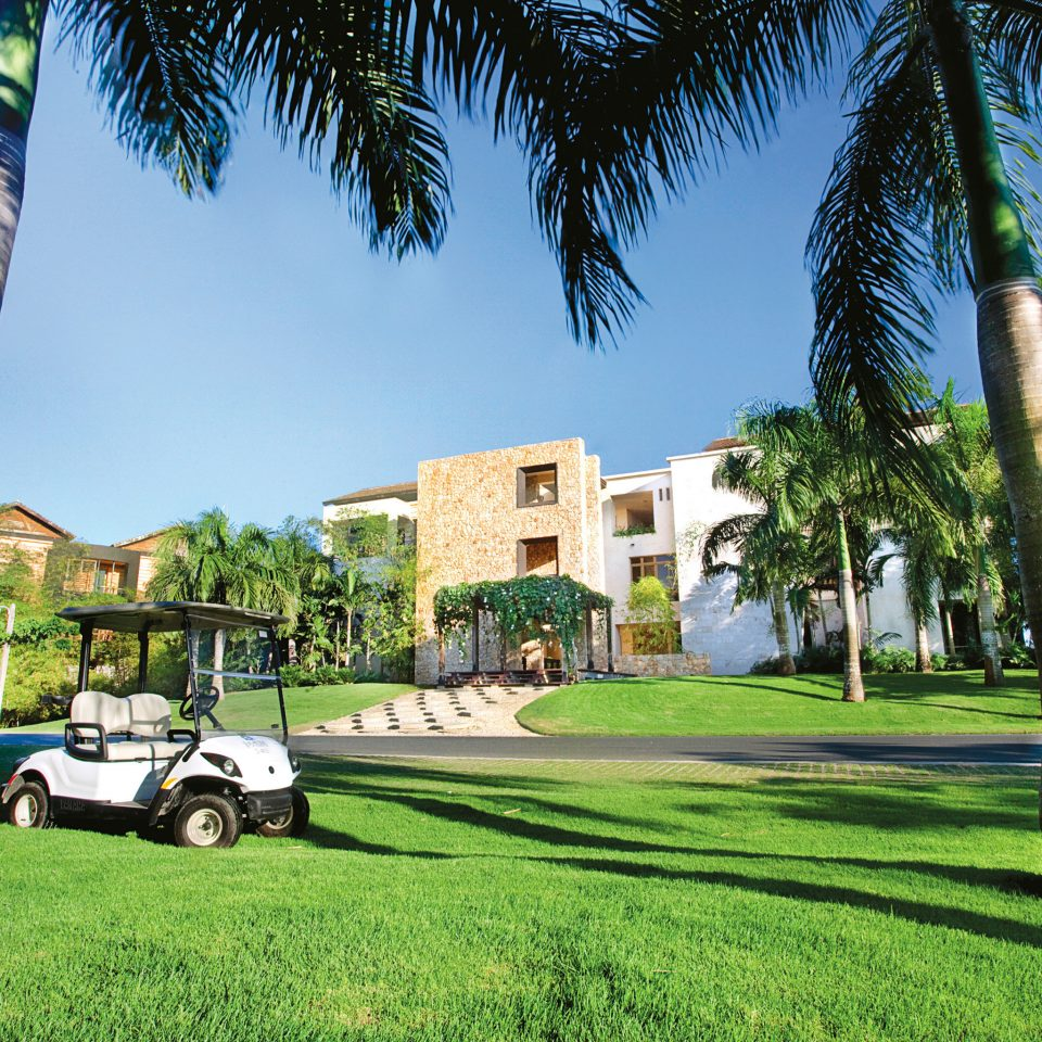 Exterior Golf Grounds Play grass tree sky plant palm neighbourhood arecales palm family woody plant home park green Resort lawn