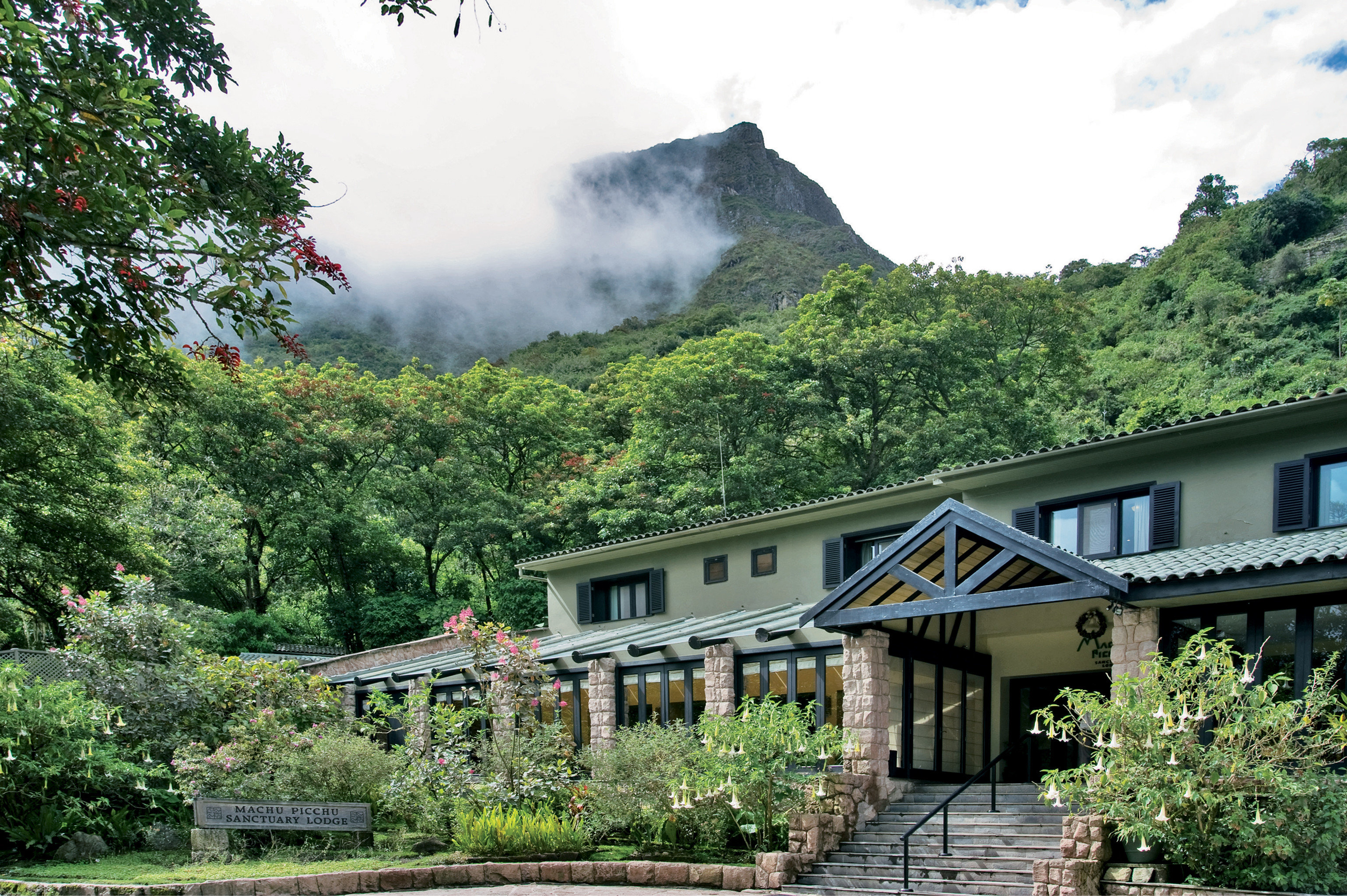 Exterior Grounds Jungle Lodge Natural wonders Nature Outdoor Activities Outdoors Scenic views Wildlife tree mountainous landforms house transport residential area mountain River rural area mountain range landscape Village valley surrounded