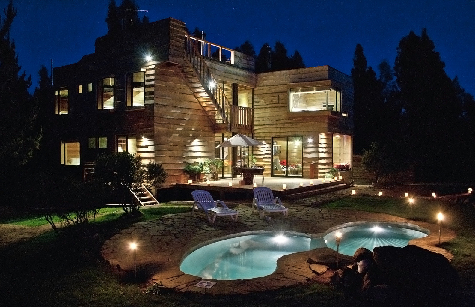 Exterior Grounds Lodge Romantic Rustic swimming pool night landscape lighting mansion light lighting evening Resort water feature backyard dark