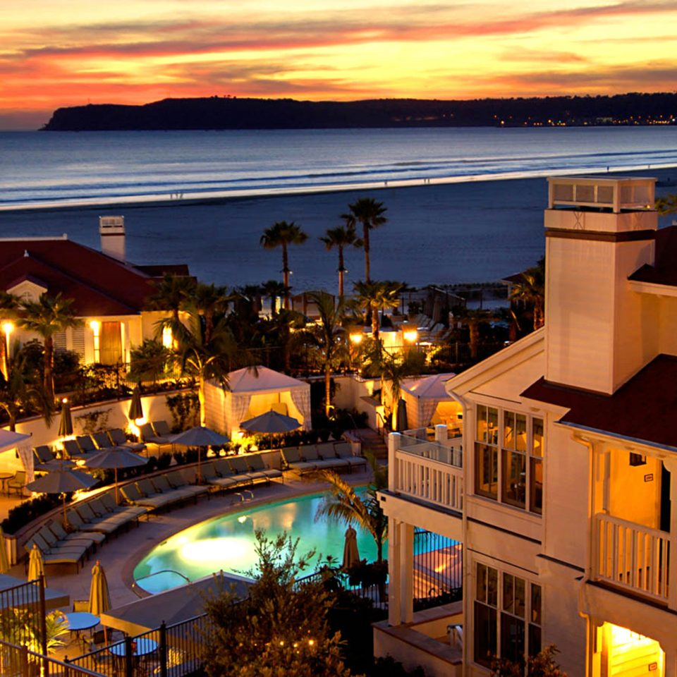 Exterior Grounds Ocean Patio Pool Romance Sunset Waterfront night evening Resort dusk