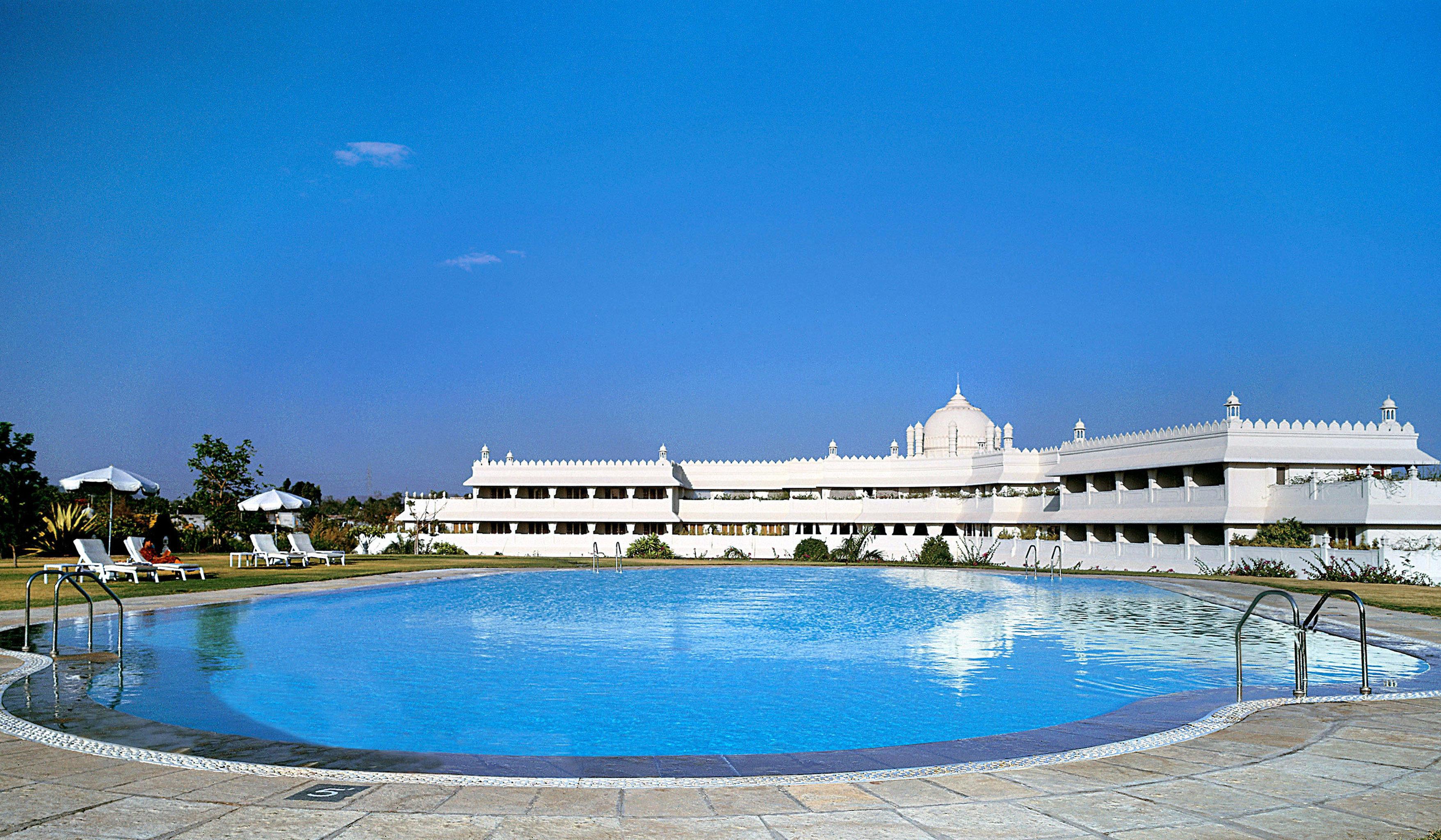 Exterior Grounds Patio Pool water sky swimming pool property Resort blue swimming palace resort town Villa Sea shore