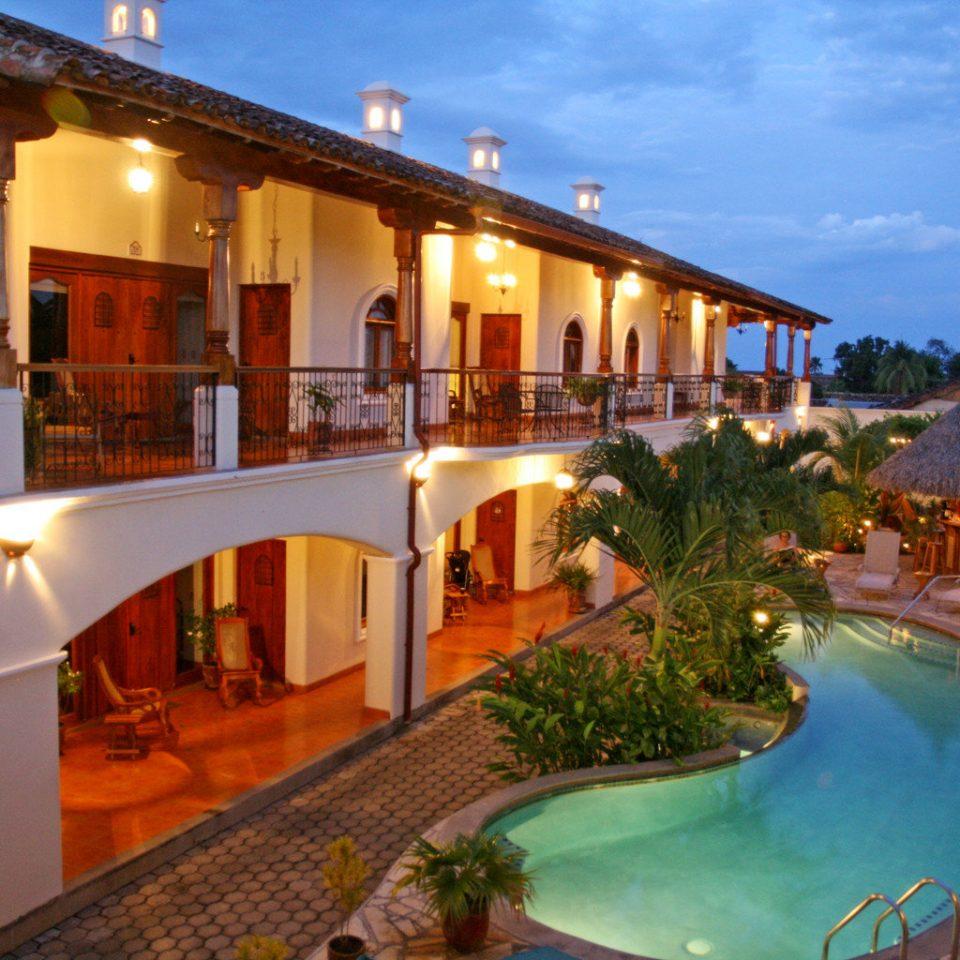 Exterior Grounds Pool Wellness sky Resort leisure property swimming pool Villa hacienda mansion resort town home eco hotel colonnade