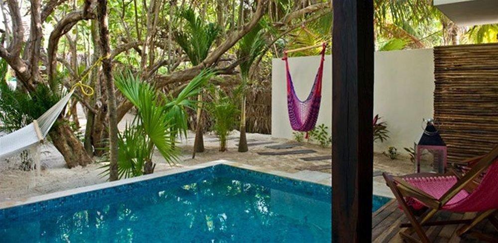 Exterior Hip Lounge Luxury Pool Tropical tree swimming pool property leisure Resort backyard Villa home hacienda cottage eco hotel porch plant