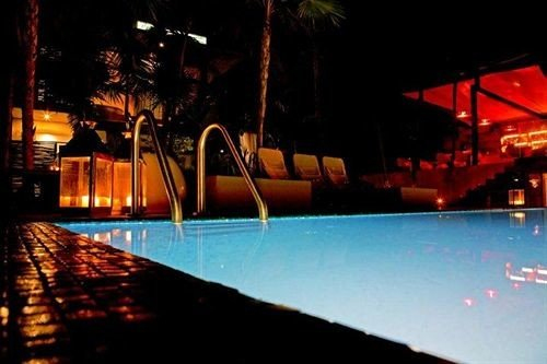 Exterior Hip Lounge Luxury Pool Tropical stage light screenshot nightclub dark night