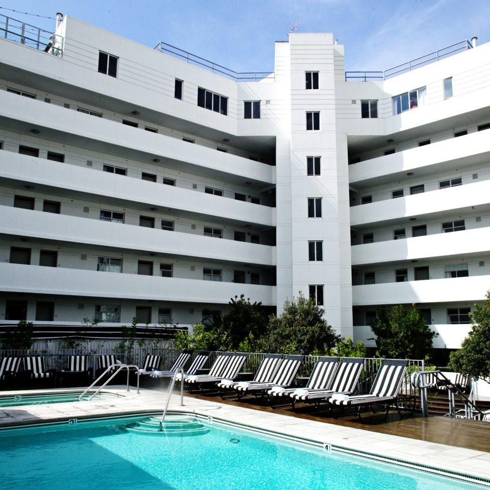 Exterior Hotels Modern Pool building condominium property plaza Resort residential area