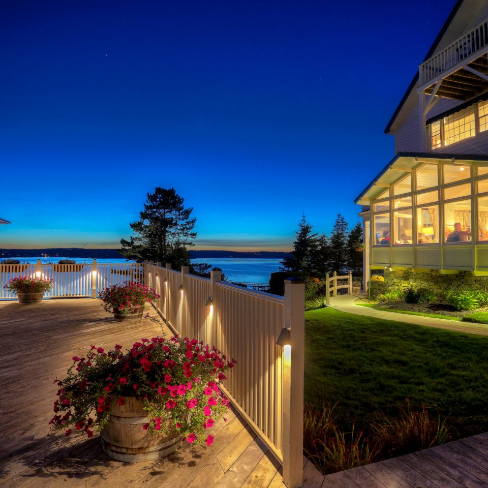Exterior Inn Ocean Patio Resort Terrace Waterfront sky house night home evening sunlight mansion Villa landscape lighting Sunset
