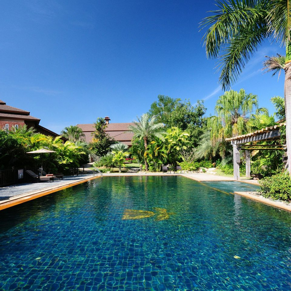 Exterior Jungle Patio Pool Tropical tree sky water swimming pool leisure property house Resort reflecting pool resort town Villa arecales mansion backyard condominium Lagoon lined swimming