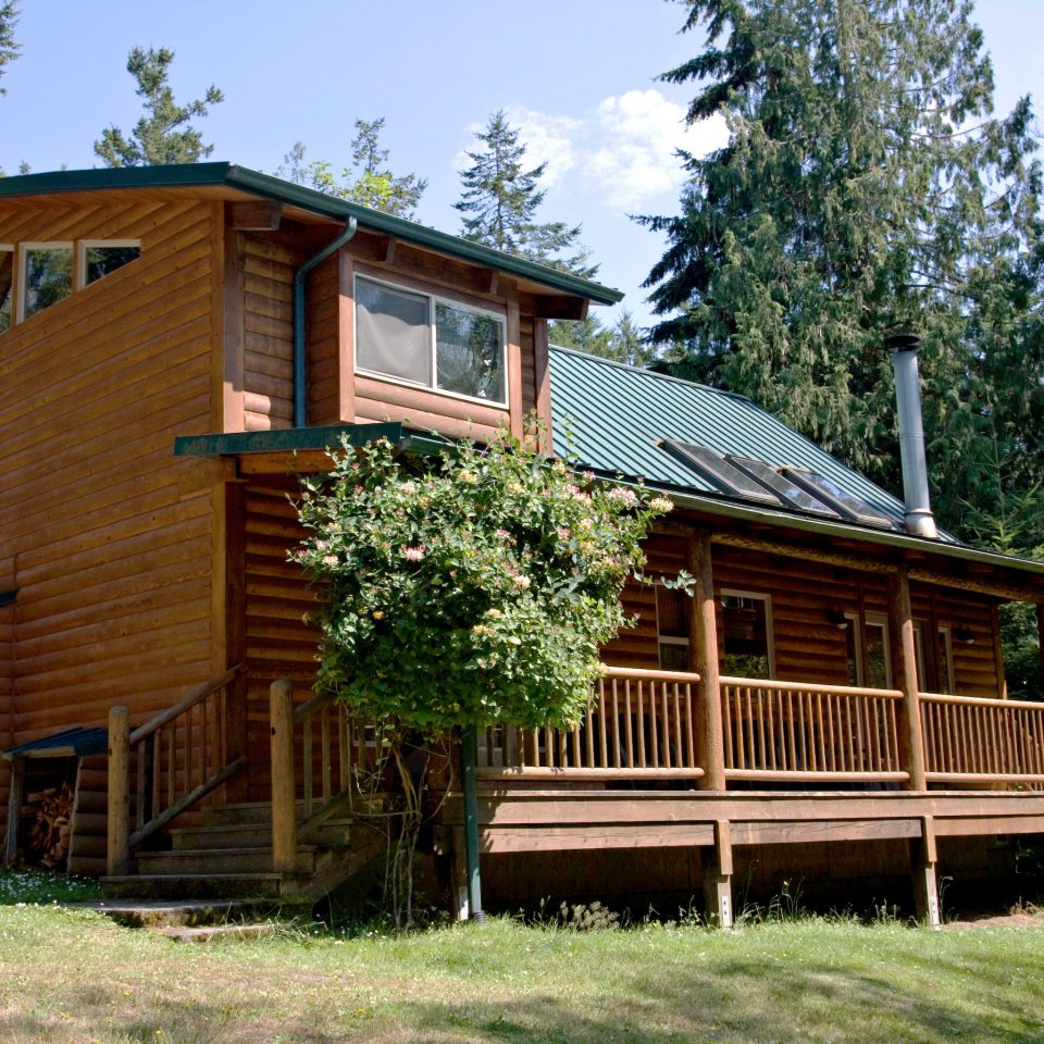 Exterior Lake Lodge Outdoors Resort Rustic Scenic views tree grass sky log cabin house building property siding home cottage farmhouse outdoor structure
