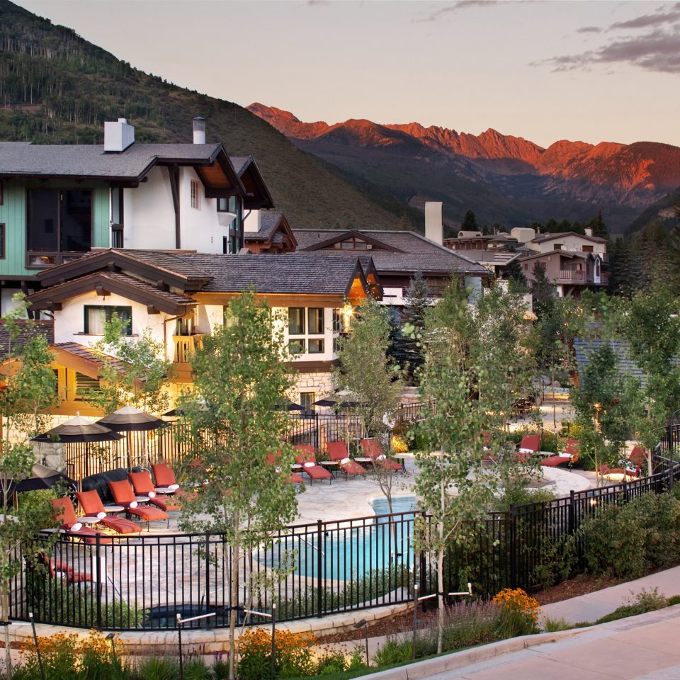 Exterior Lodge Mountains Nature Outdoors Pool Scenic views building house mountain Town neighbourhood residential area Village home suburb flower Resort cityscape stone