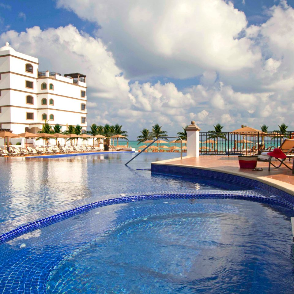 Exterior Lounge Luxury Pool Resort Tropical sky leisure swimming pool condominium marina Sea dock day