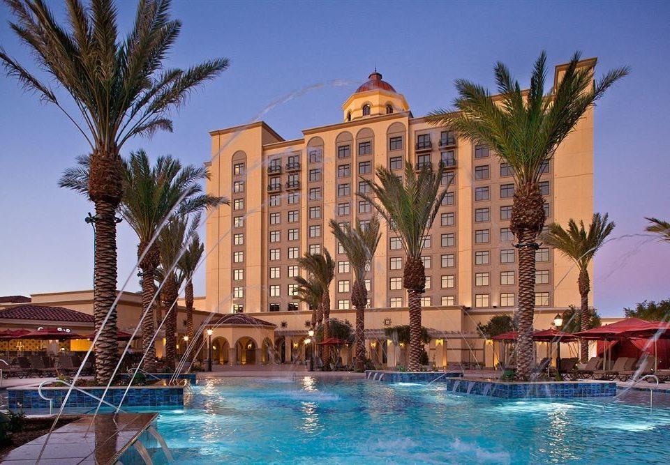 Exterior Lounge Pool sky water tree Resort swimming pool arecales palace condominium plaza Villa hacienda mansion amusement park palm