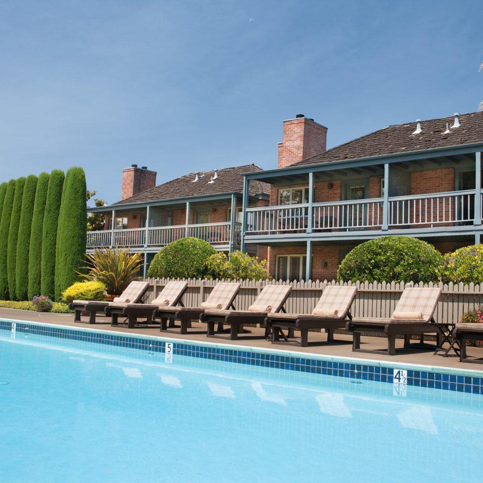 Exterior Lounge Pool water swimming pool condominium property building Resort Villa blue swimming