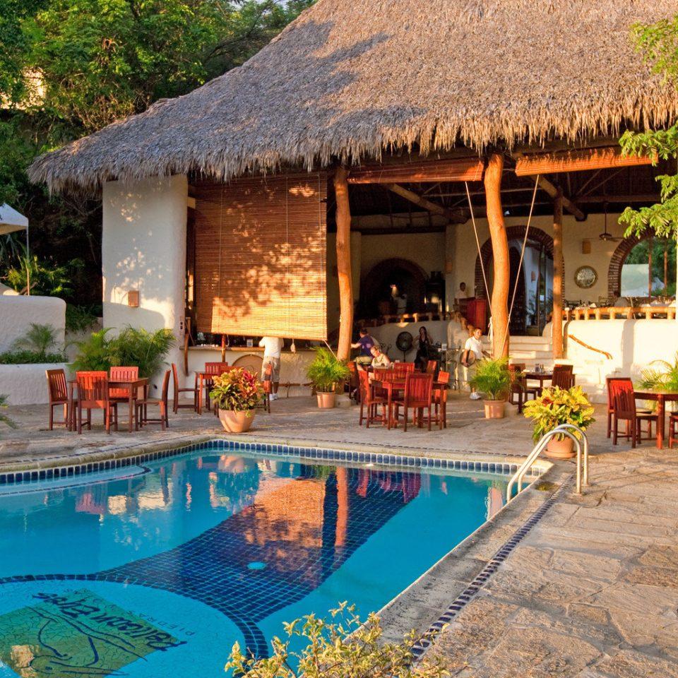 Exterior Luxury Pool Rustic Tropical Villa tree swimming pool leisure property Resort building hacienda eco hotel Village