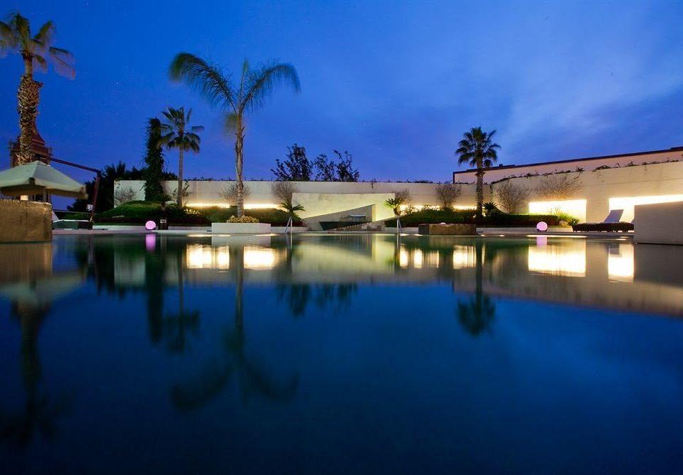 Exterior Modern Pool Tropical sky water swimming pool night evening reflecting pool light lighting dusk Resort waterway