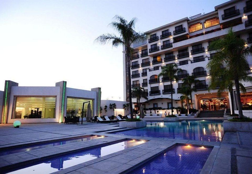 Exterior Modern Pool Tropical sky condominium property swimming pool building plaza Resort