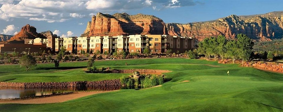 Exterior Resort grass sky mountain structure sport venue Nature golf course golf club castle lush