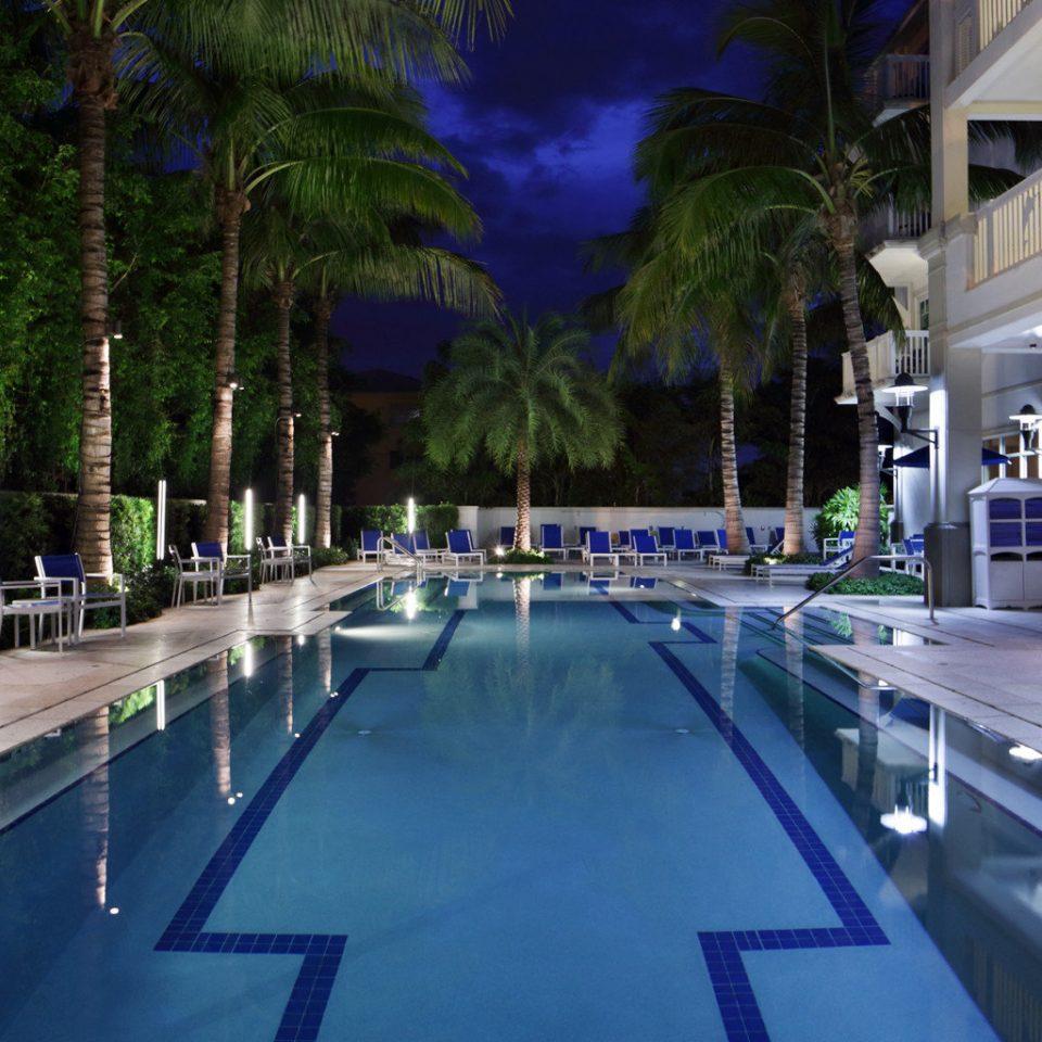 Exterior Pool tree swimming pool leisure Resort condominium reflecting pool way road lined