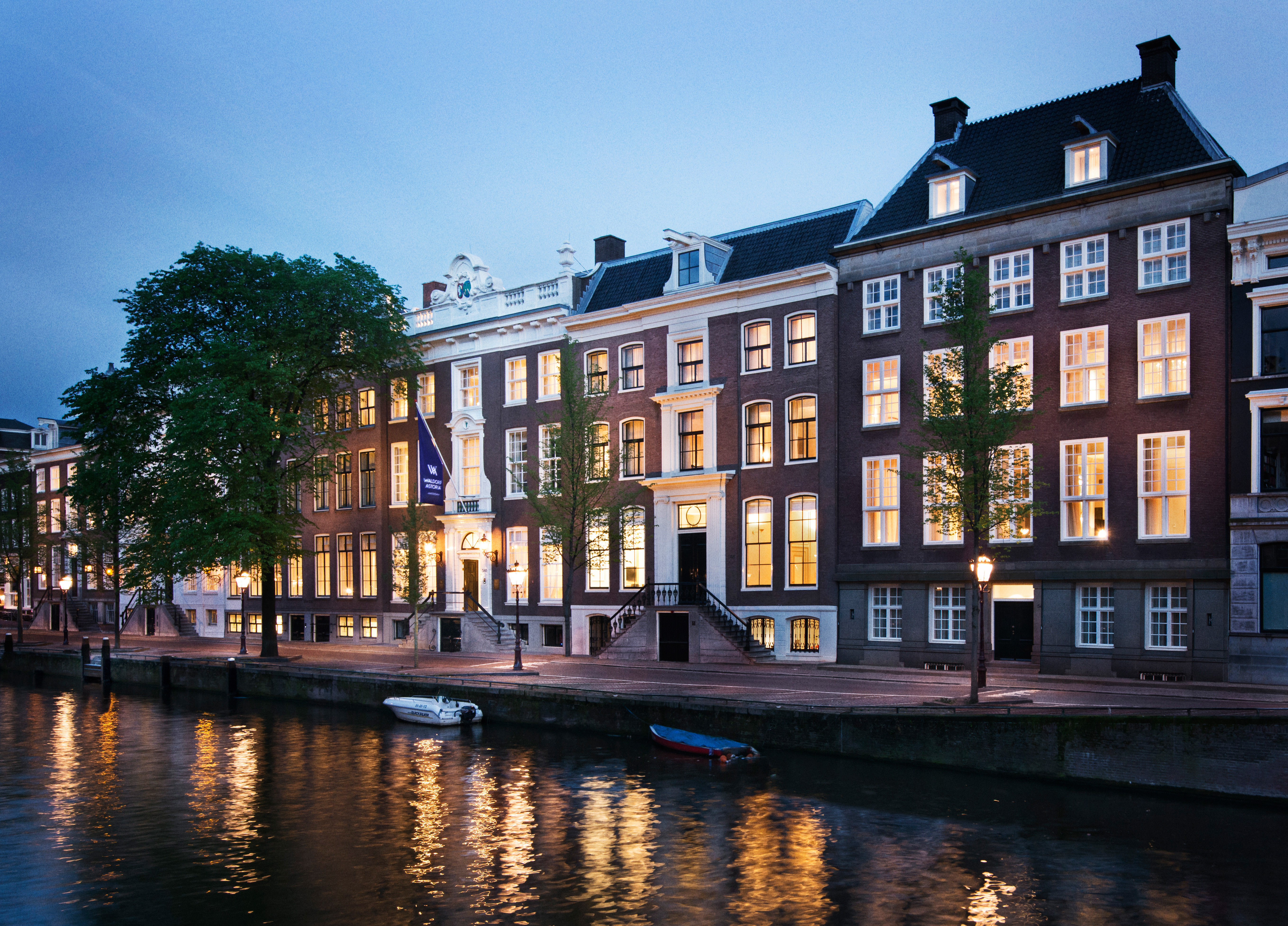 Amsterdam Architecture Buildings City Elegant Exterior Family Hotels Luxury Romantic The Netherlands Waterfront sky building outdoor water Canal waterway body of water Town landmark reflection house evening estate cityscape several
