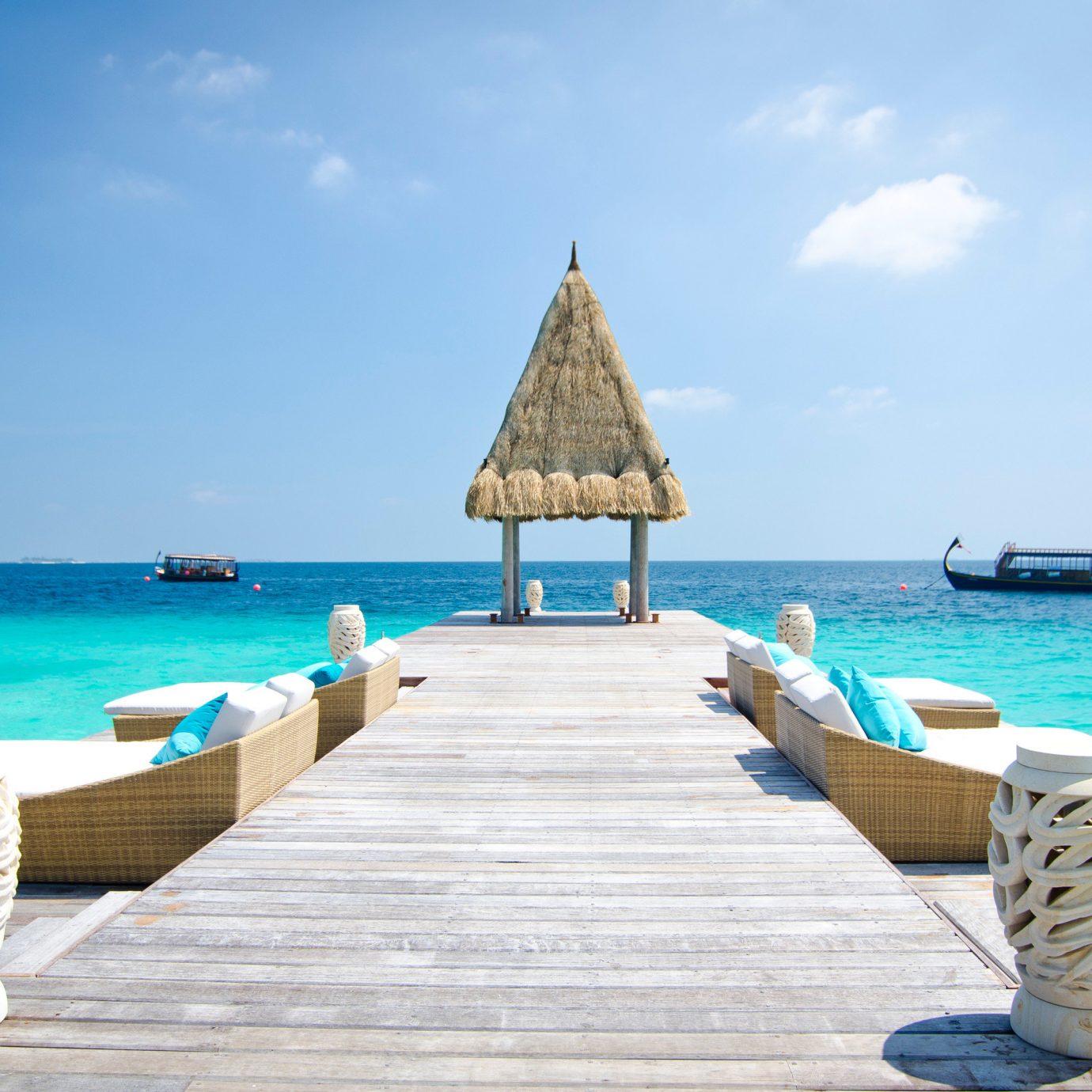 Hotels sky water ground Sea Beach leisure chair outdoor shore vacation horizon Ocean caribbean Coast bay Island sand Lagoon Resort cape facing day