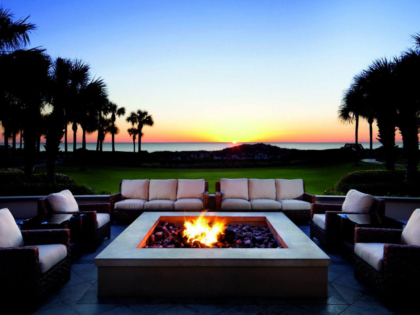 Firepit Hotels Living Lounge Sunset sky outdoor estate lighting evening swimming pool home landscape lighting dusk furniture