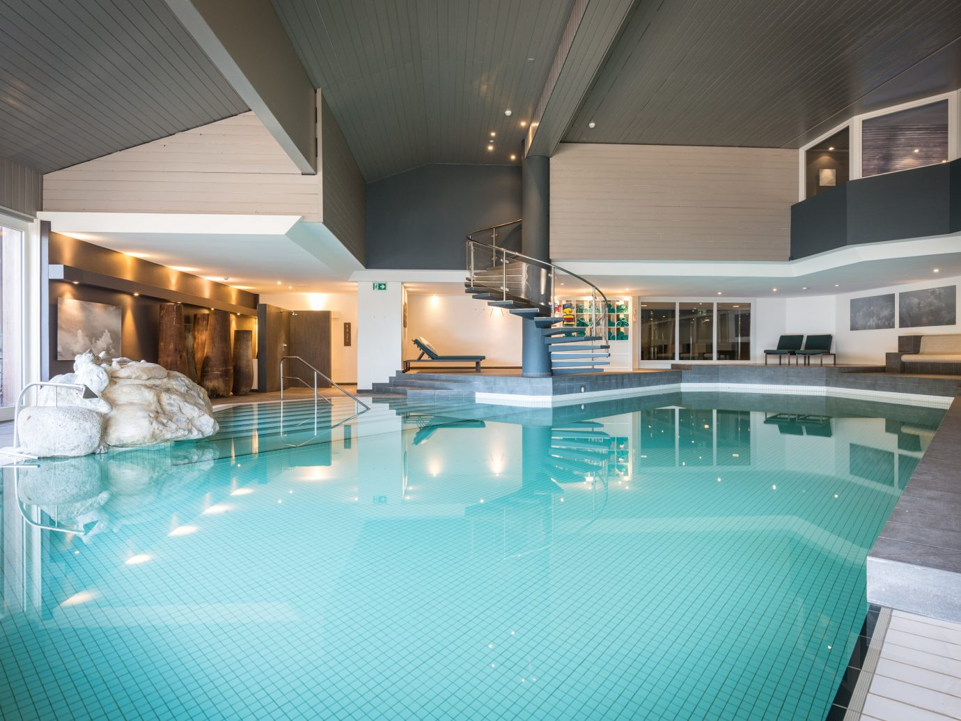 Boutique Hotels Hotels Outdoors + Adventure Winter ceiling indoor floor swimming pool chair leisure centre leisure Architecture estate real estate thermae interior design amenity apartment resort town daylighting Pool hotel penthouse apartment furniture