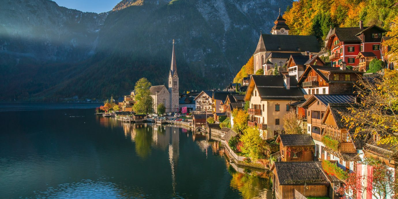 Trip Ideas mountain outdoor sky water mountainous landforms reflection Town tree body of water Lake mountain range season River Nature autumn landscape alps flower fjord Village surrounded