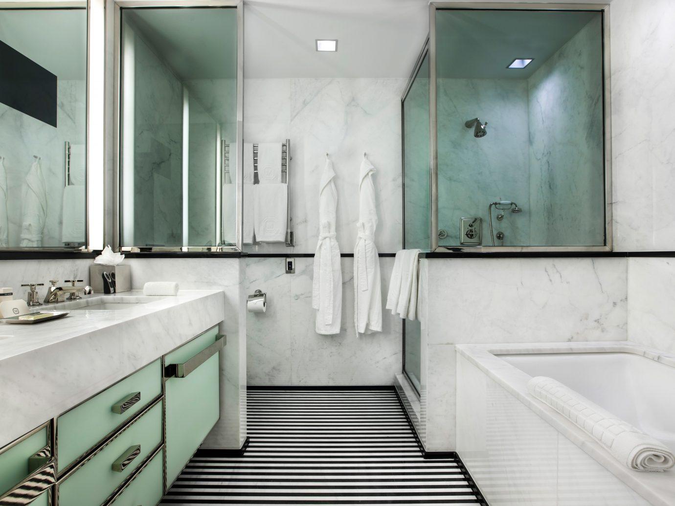 Bath City Hotels Luxury Offbeat indoor wall bathroom room property floor interior design plumbing fixture toilet Design sink public toilet estate bathtub tub