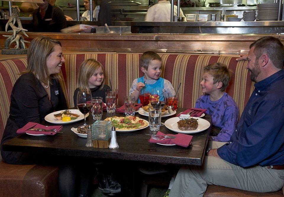 sitting lunch dinner group restaurant Family