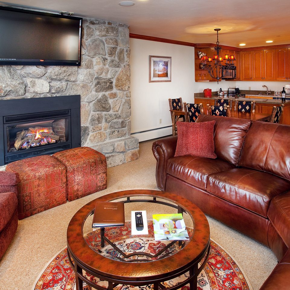Family Fireplace Kitchen Lodge Luxury Rustic sofa leather living room chair brown property home cottage rug Suite seat flat