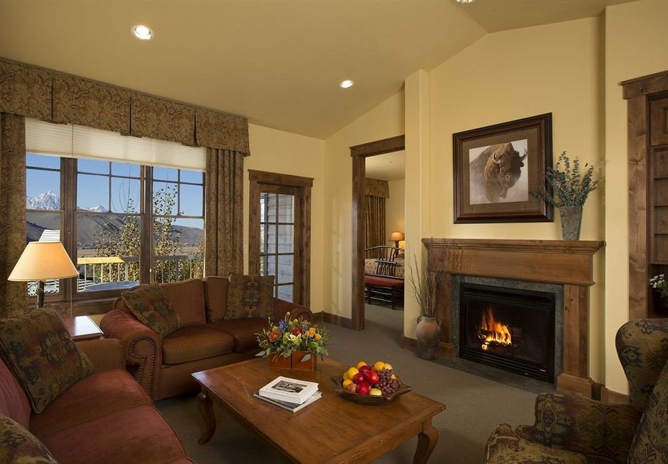 Family Lodge Suite sofa Fireplace living room fire property home hardwood mansion cottage Villa condominium flat leather