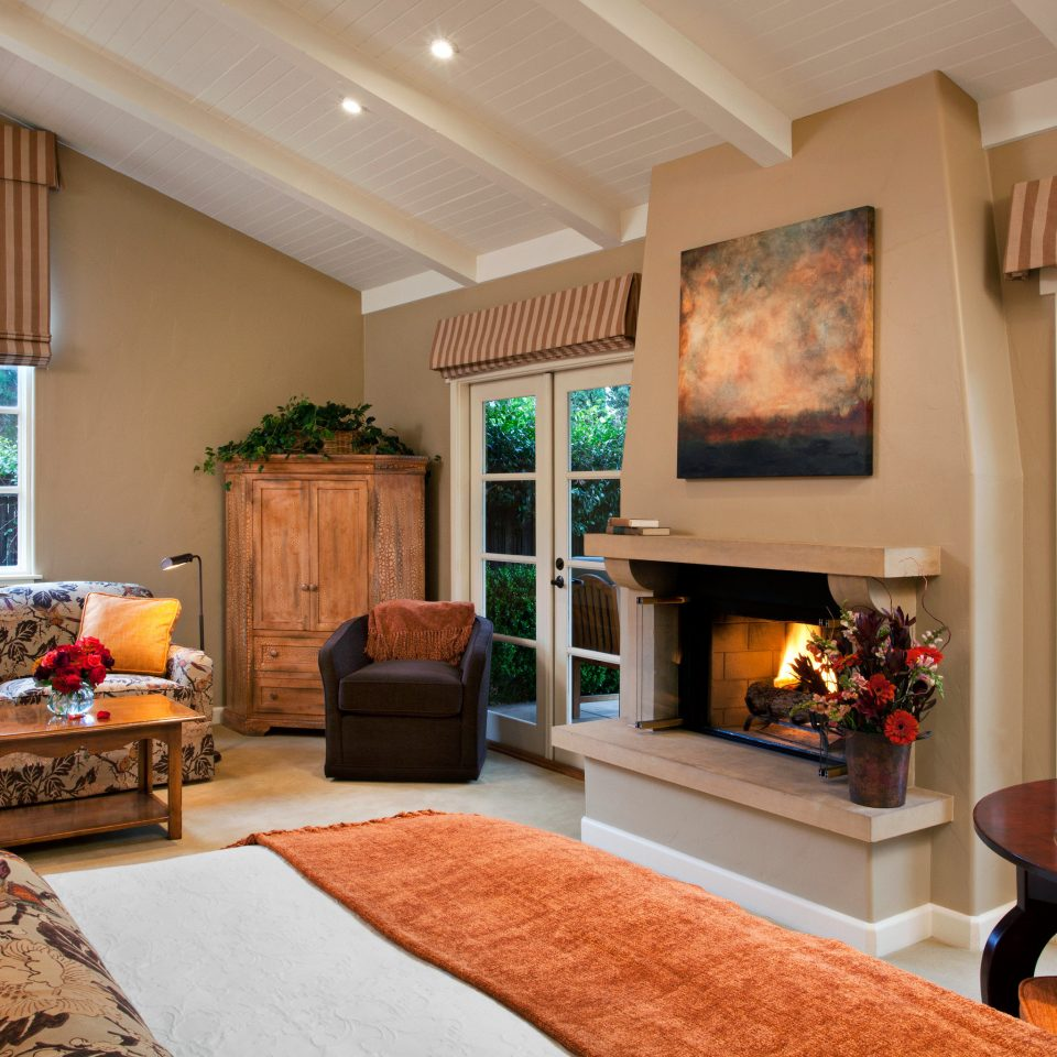 Family Fireplace Lounge Romance Suite sofa living room property home hardwood cottage condominium Villa stone