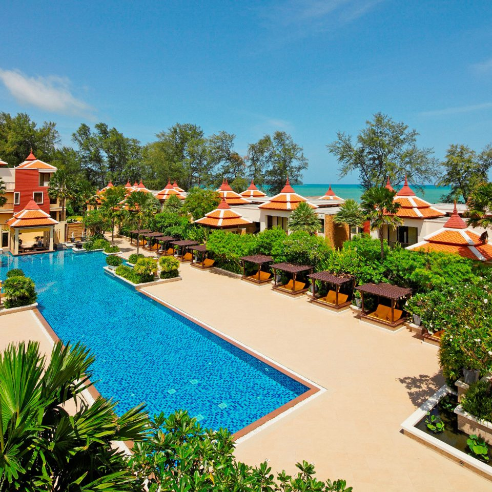 Family Outdoors Play Pool Resort tree sky property leisure swimming pool resort town Villa Village lawn Water park caribbean plant lined colorful Garden day