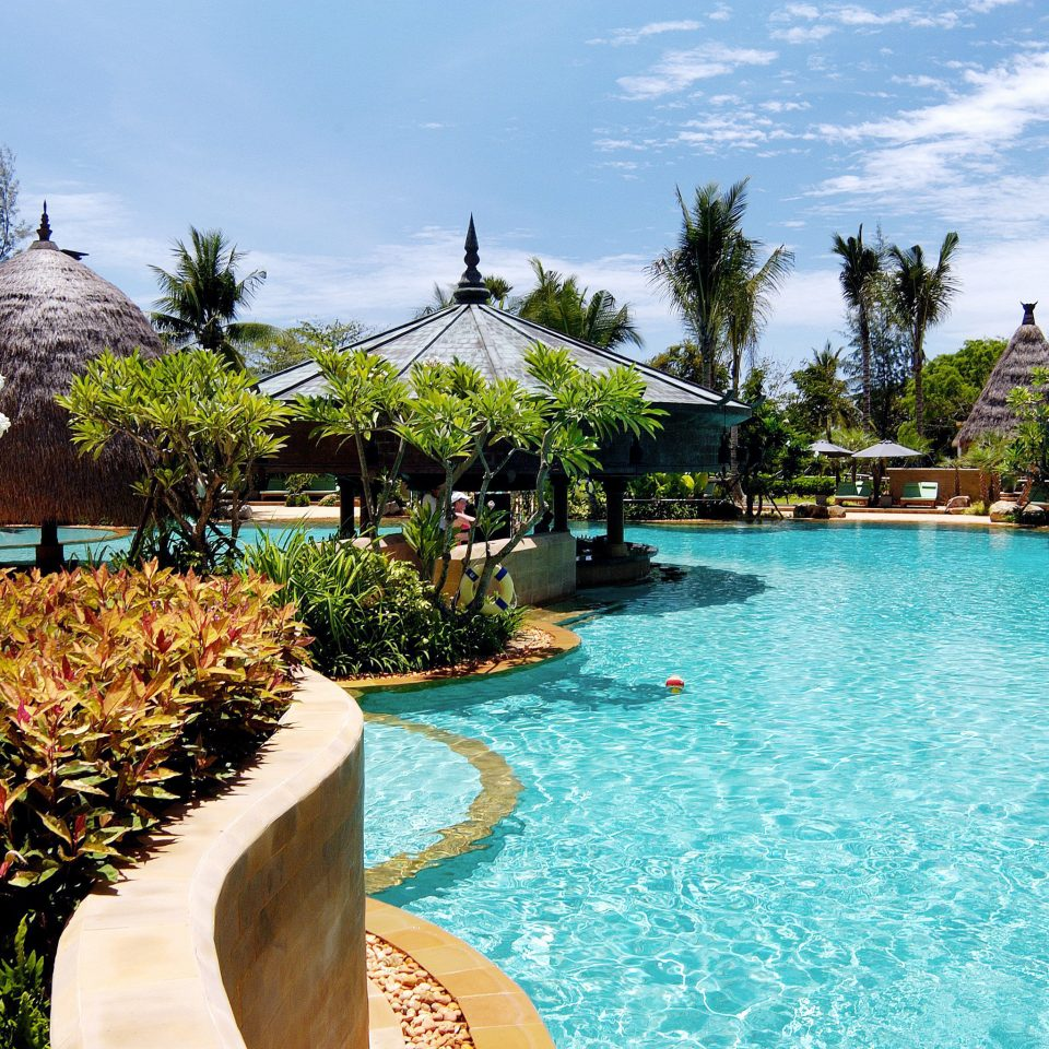 Family Play Pool Resort Scenic views tree sky water swimming pool property leisure resort town Villa caribbean backyard lined palm swimming surrounded Garden