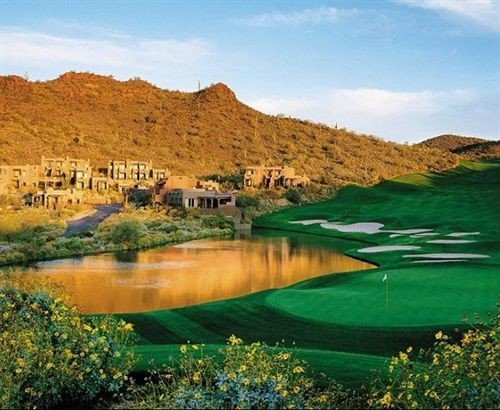 Family Golf sky mountain water grass structure Nature Lake grassland sport venue golf course green plateau golf club loch pond surrounded hillside