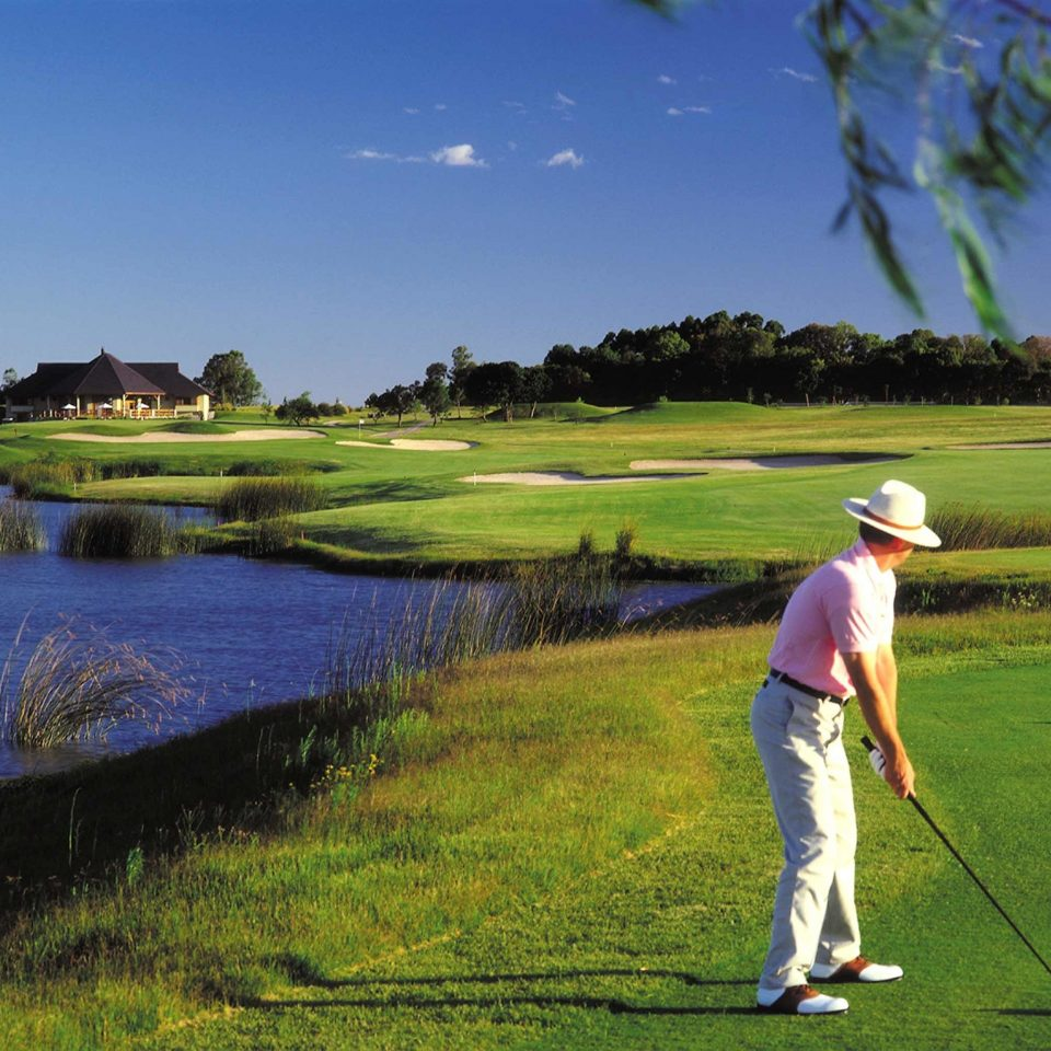 Family Golf Luxury Outdoor Activities Resort Rustic Sport grass sky structure athletic game sports ball game pitch and putt sport venue field green grassland golf course outdoor recreation golf club recreation individual sports meadow grassy lush