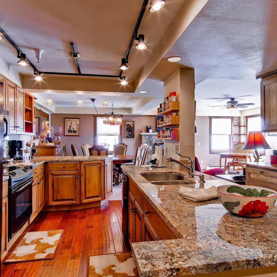 Family Kitchen Mountains Ski property home house countertop cottage living room cabinetry appliance
