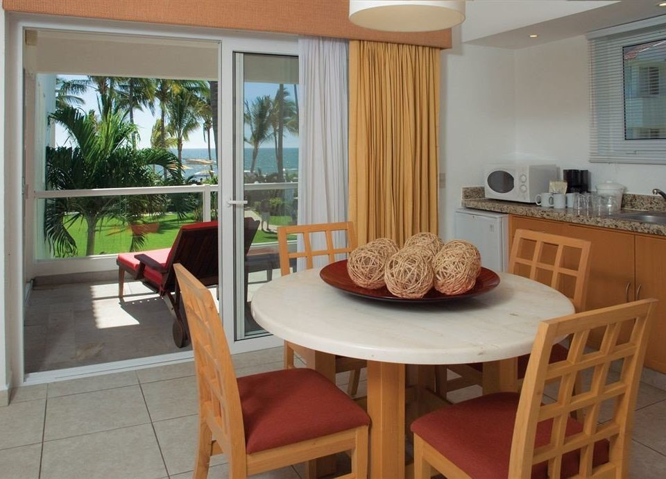 Family Kitchen Suite Tropical property home cottage hardwood condominium Villa living room dining table