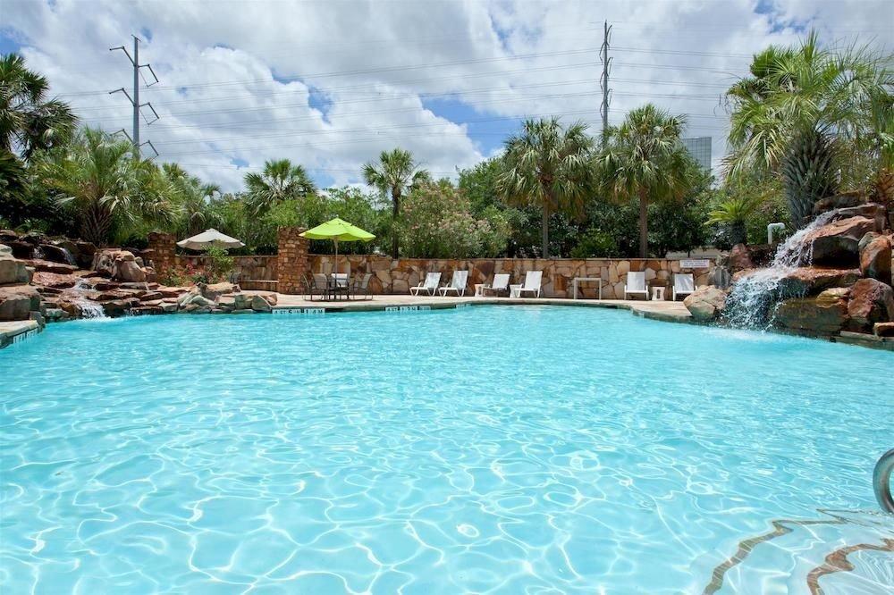Family Pool water tree sky swimming pool swimming property Resort resort town Lagoon blue Villa backyard surrounded