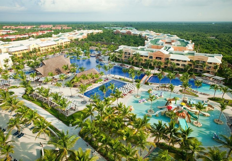Family Lounge Pool Resort Tropical leisure ecosystem Water park Nature amusement park caribbean park bird's eye view marina shore