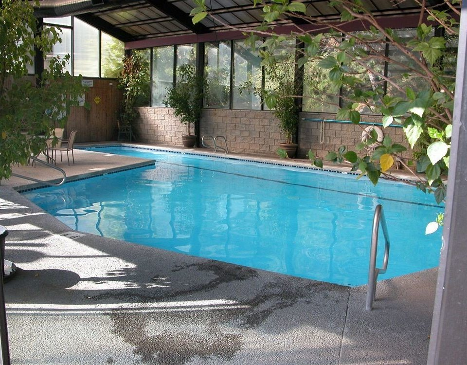 Family Pool Resort ground swimming pool property backyard blue yard Villa outdoor structure