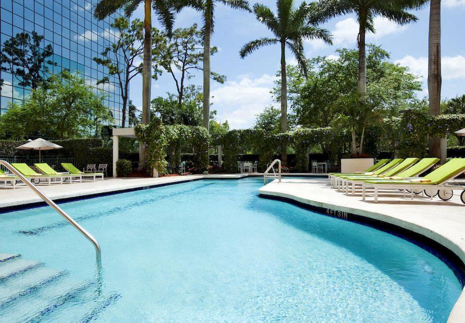 Family Pool tree sky water swimming pool property leisure Resort condominium reflecting pool Villa backyard swimming