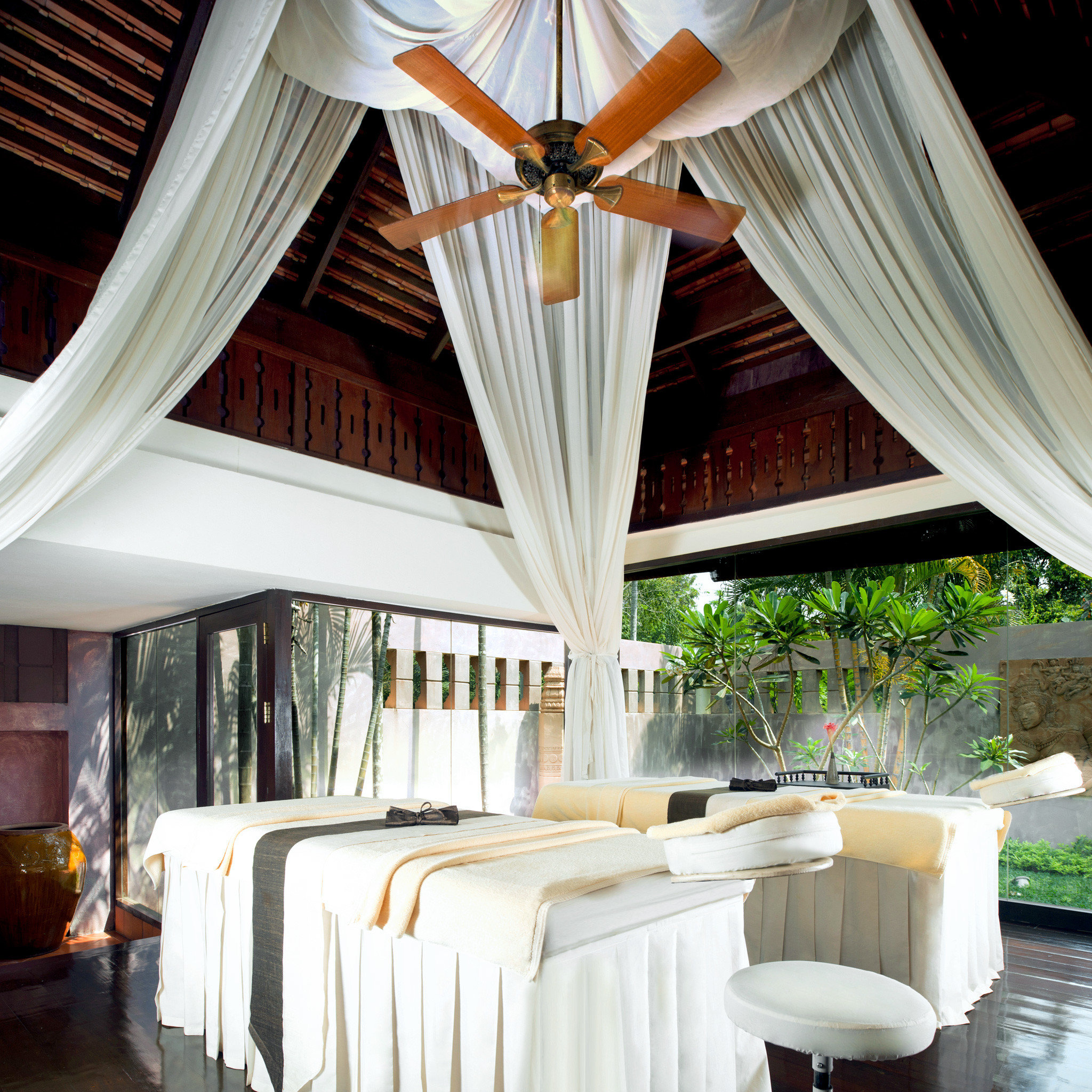 Family Resort Spa Wellness chair curtain property home porch window treatment living room