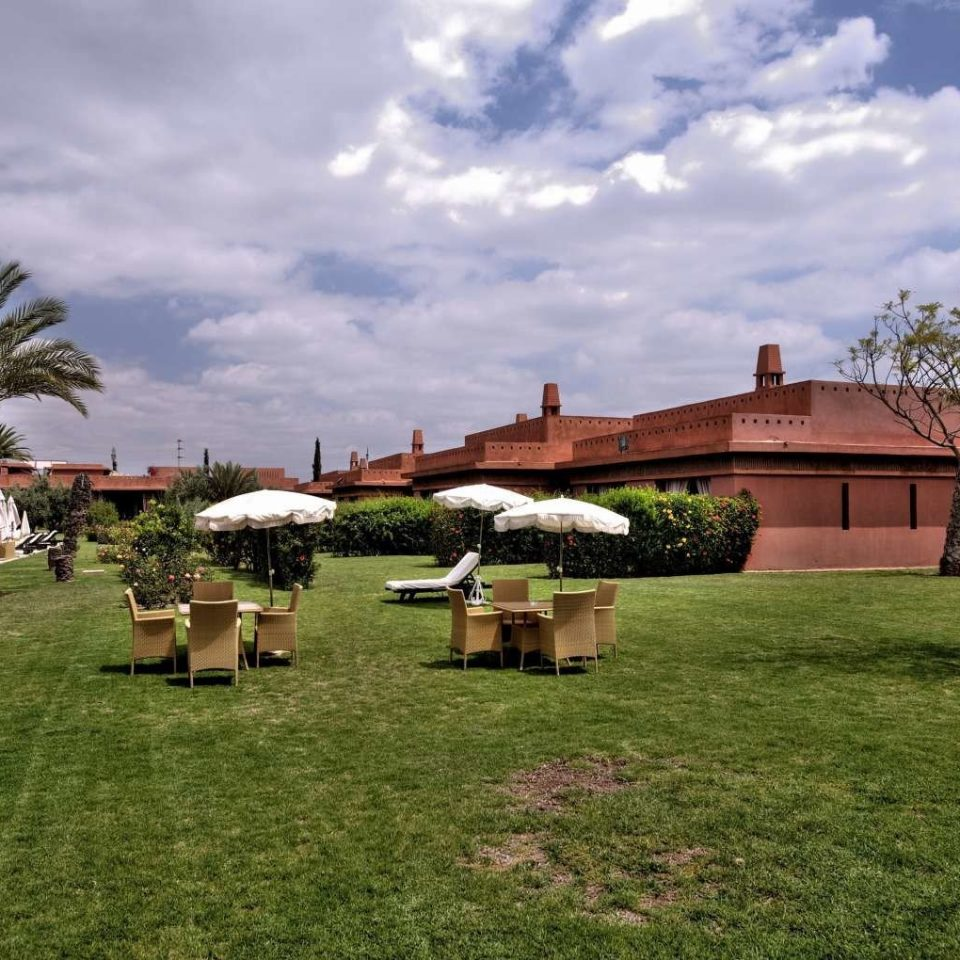 grass sky house residential area home rural area lawn Farm Village backyard Resort flower Garden grassy park hacienda yard lush day