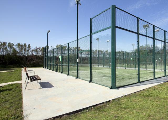 grass sky structure sport venue net baseball field outdoor structure Fence park