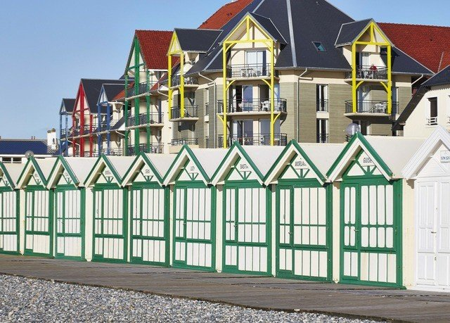 building property house home gate green Fence residential area outdoor structure cottage shed