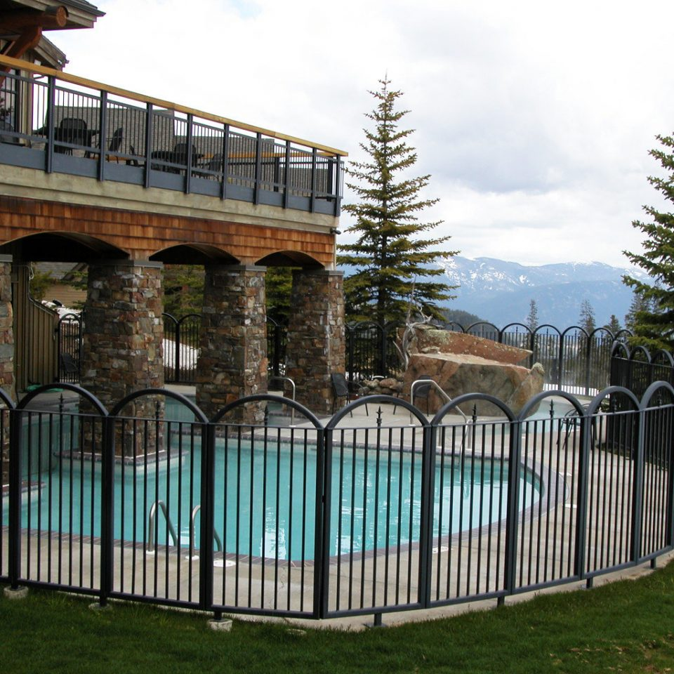 Lodge Pool Resort Ski grass sky building Fence gate outdoor structure picket fence home fencing walkway