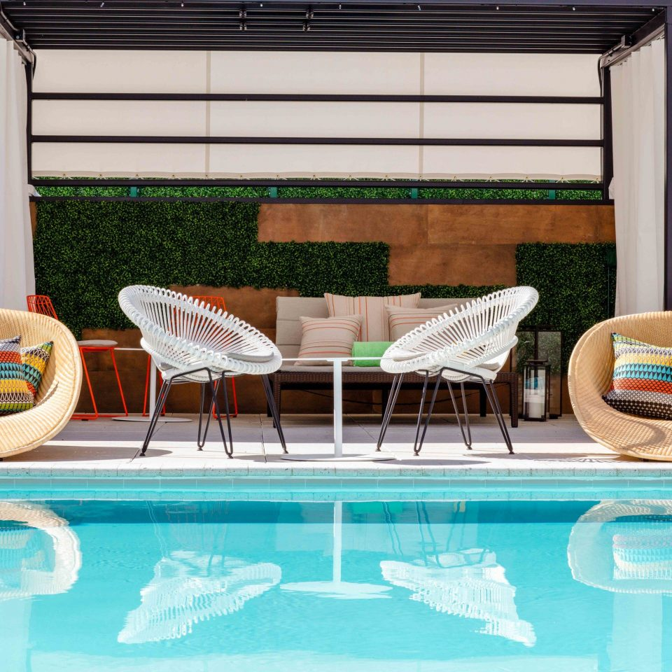 property swimming pool sunlounger outdoor furniture leisure outdoor structure chair Patio Resort Fence amenity