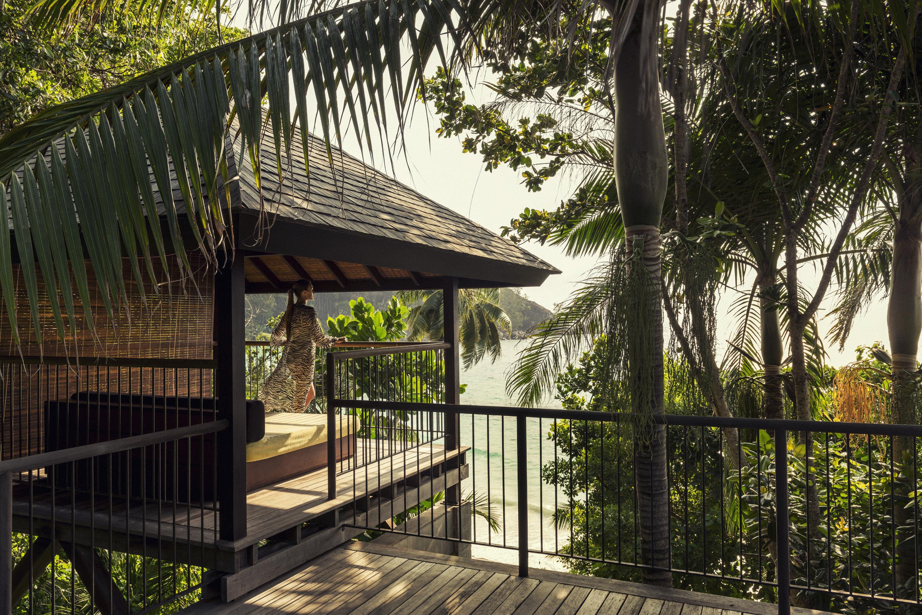 Fence tree building park outdoor structure metal cottage backyard Resort walkway