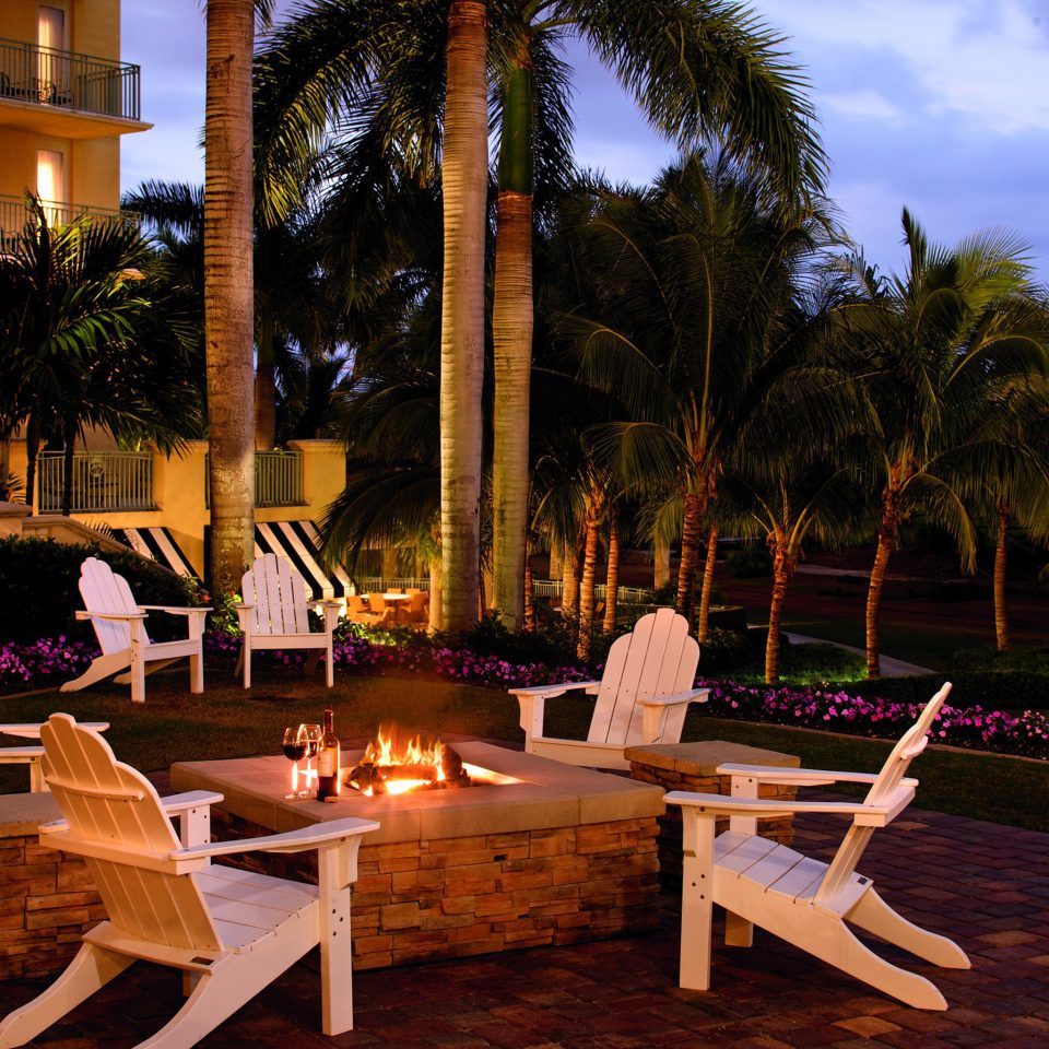Firepit Lounge Luxury Outdoors Patio Romance Romantic Sunset Tropical tree leisure Resort home backyard restaurant Villa
