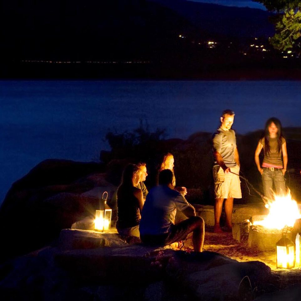 Firepit Lounge Luxury Waterfront water campfire night lit candle bonfire darkness lighting dark evening fire light